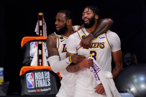 Los Angeles Lakers' LeBron James (23) and Anthony Davis (3) celebrate after the Lakers defeated ...