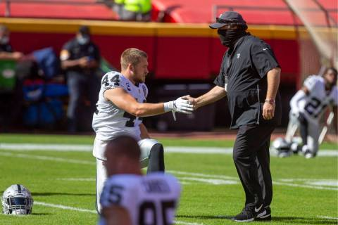 Las Vegas Raiders inside linebacker Nick Kwiatkoski (44) greets defensive coordinator Paul Guen ...