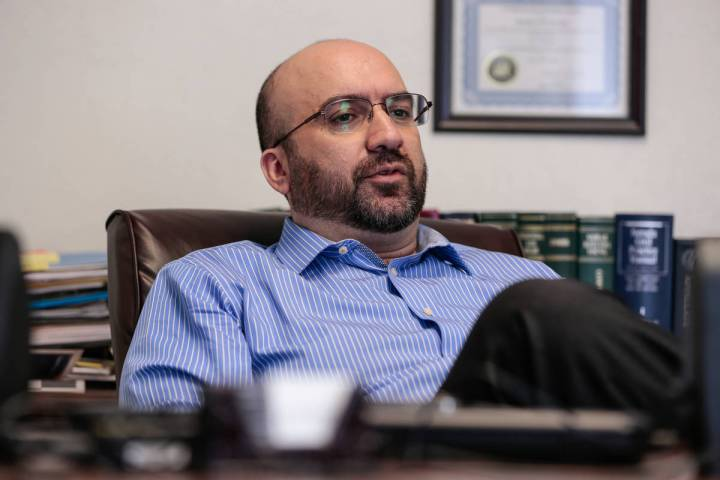 Lawyer Alex Ghibaudo pauses during an interview in his Las Vegas office on Feb. 18, 2015. (Revi ...
