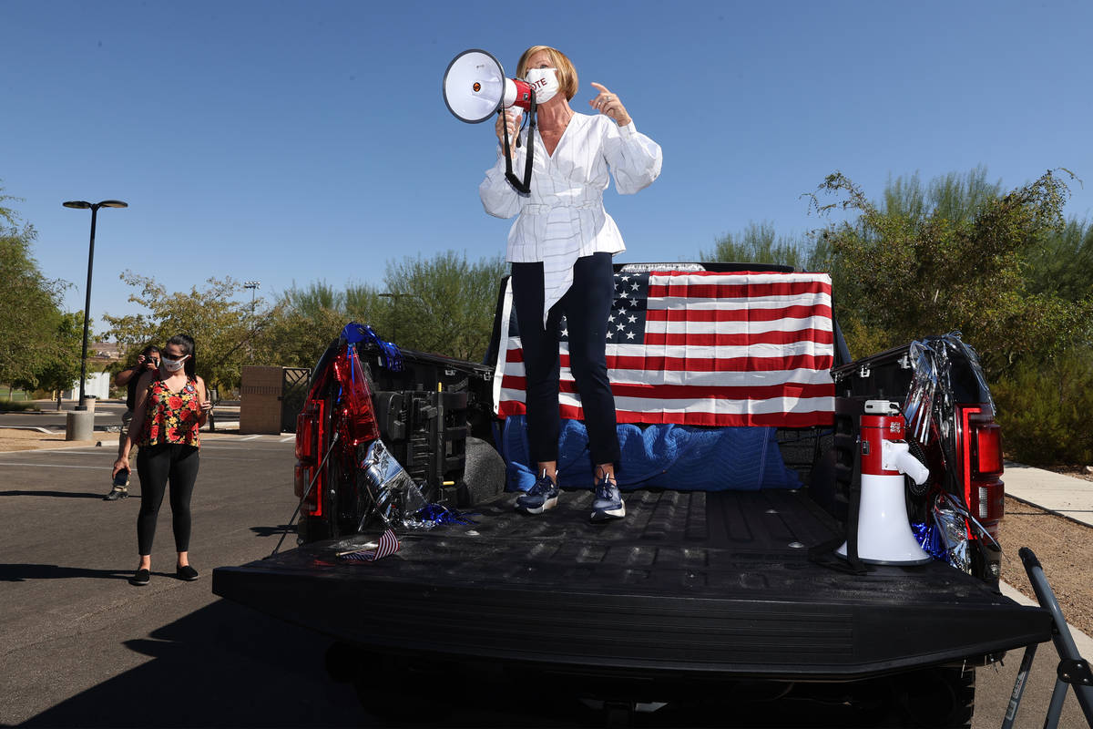 U.S. Rep. Susie Lee, D-Nev., speaks to supporters before a ballot drop off parade at Heritage ...