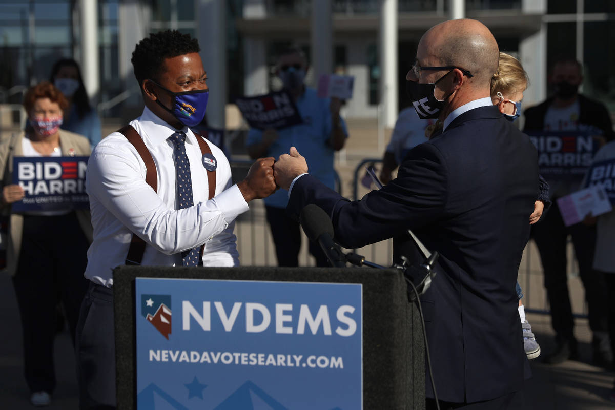 Las Vegas Councilman Brian Knudsen, right, with his daughter Kate, 2, introduces State Assembl ...