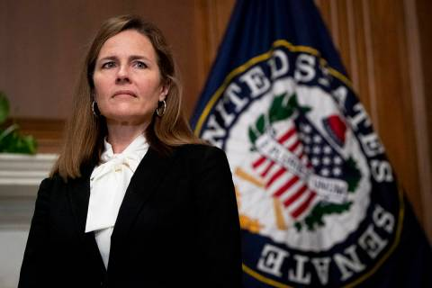 Supreme Court nominee Judge Amy Coney Barrett, meets with Sen. Joni Ernst, R-Iowa, not shown, T ...