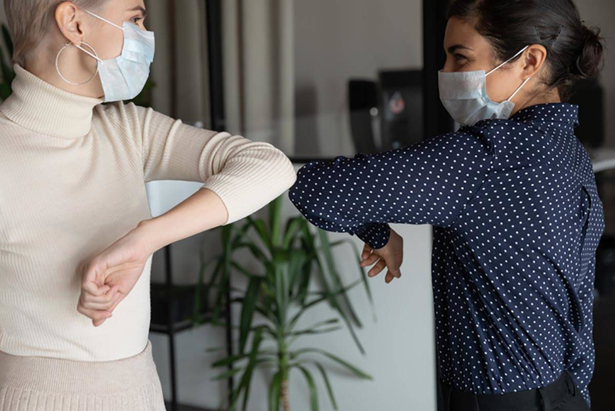 Because of the COVID-19 pandemic, social distancing, face masks, optional elbow bumps and other ...