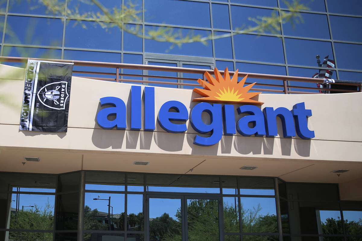 A Raiders flag hangs in front of the Allegiant headquarters in Las Vegas, Monday, Aug. 5, 2019. ...