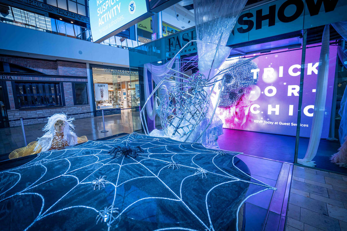 The Great Hall features a spider web installation and mummy fashion exhibit. (Fashion Show mall)