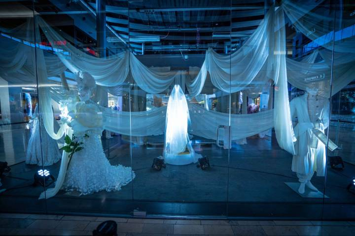 The Great Hall to snap photos of a spider web installation and mummy fashion exhibit. (Fashion ...