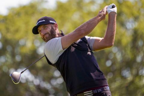 In this Saturday, Sept. 19, 2020, file photo, Dustin Johnson hits from the fourth tee during th ...