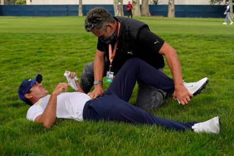 This Aug. 7, 2020, file photo shows Brooks Koepka getting treated for an injury on the 12th hol ...