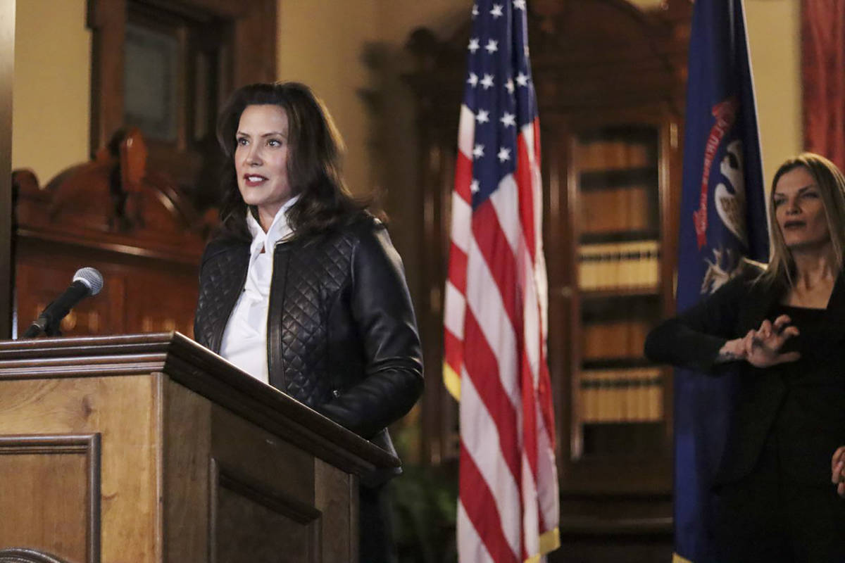 Michigan Gov. Gretchen Whitmer addresses the state during a speech in Lansing, Mich. (Michigan ...
