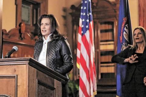 Michigan Gov. Gretchen Whitmer addresses the state during a speech in Lansing, Mich. (Michigan ...