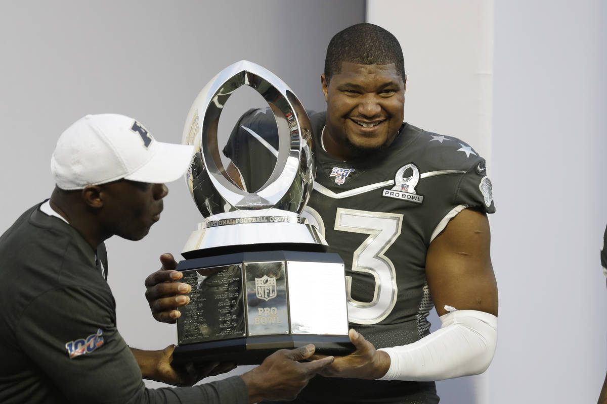 AFC defensive end Calais Campbell, of the Jacksonville Jaguars, (93) holds the Pro Bowl trophy ...