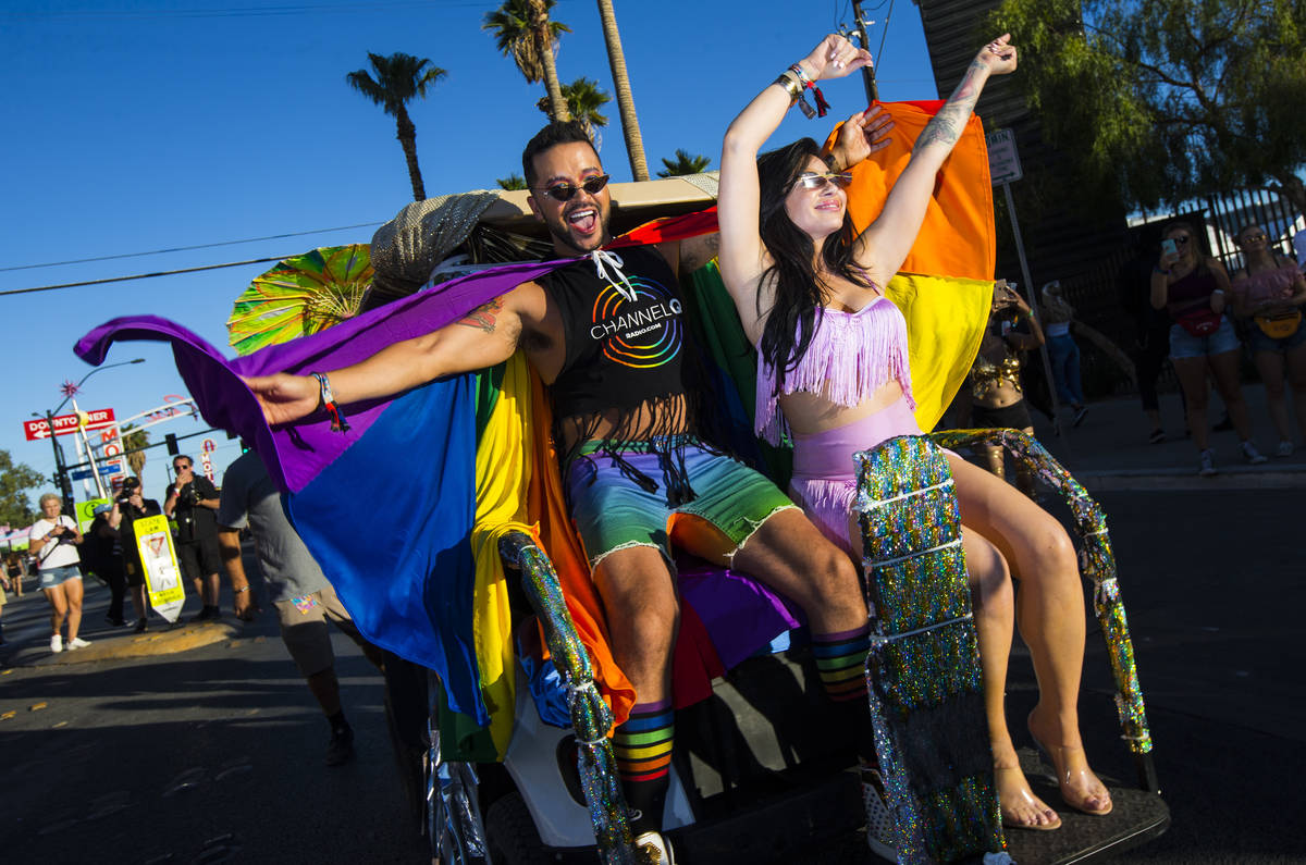 Actor Jai Rodriguez, left, and singer Mikalah Gordon, lead the pride parade as grand marshals d ...