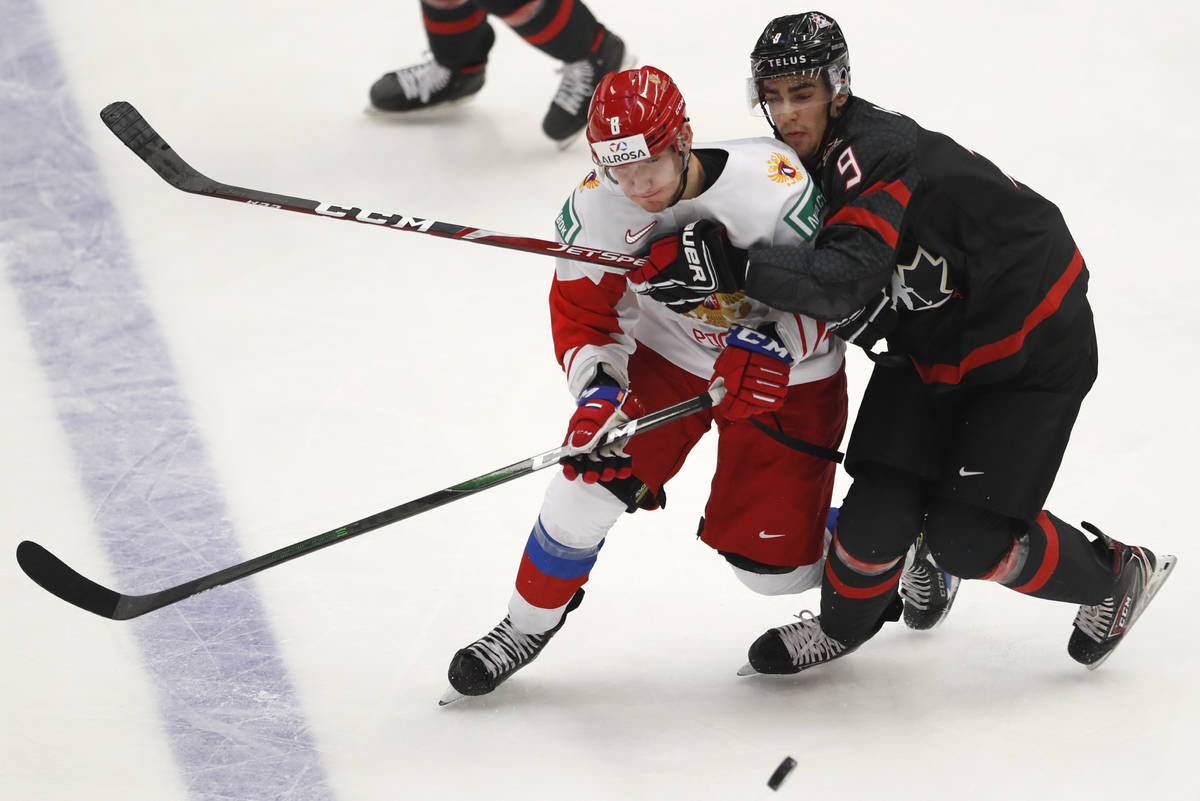 Canada's Joe Veleno, right, challenges Russia's Ivan Morozov during the U20 Ice Hockey Worlds g ...