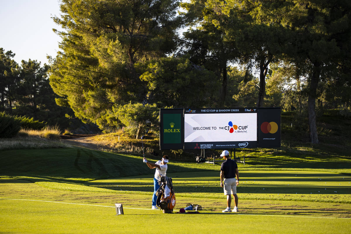 A golfer warms up in the driving range ahead of the CJ Cup at the Shadow Creek Golf Course in N ...