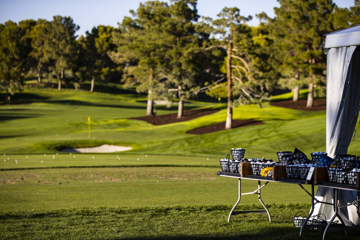 Golf balls are seen at the driving range ahead of the CJ Cup at the Shadow Creek Golf Course in ...