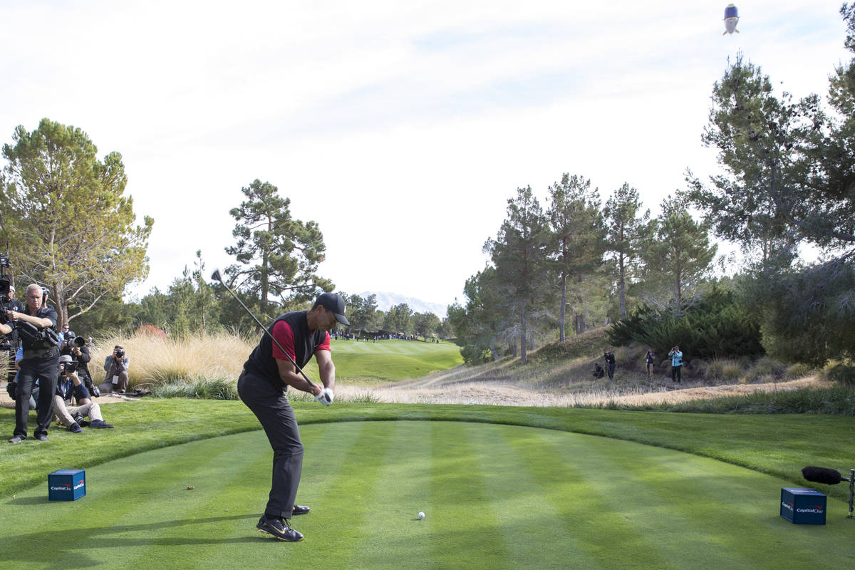 Tiger Woods hits from the second tee box during The Match at Shadow Creek Golf Course in North ...