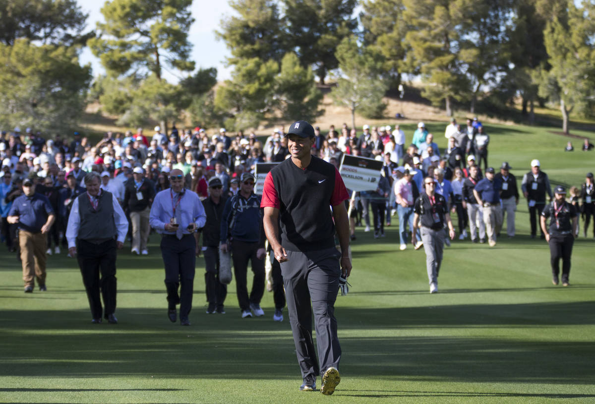 Tiger Woods walks the fourth fairway during The Match at Shadow Creek Golf Course in North Las ...