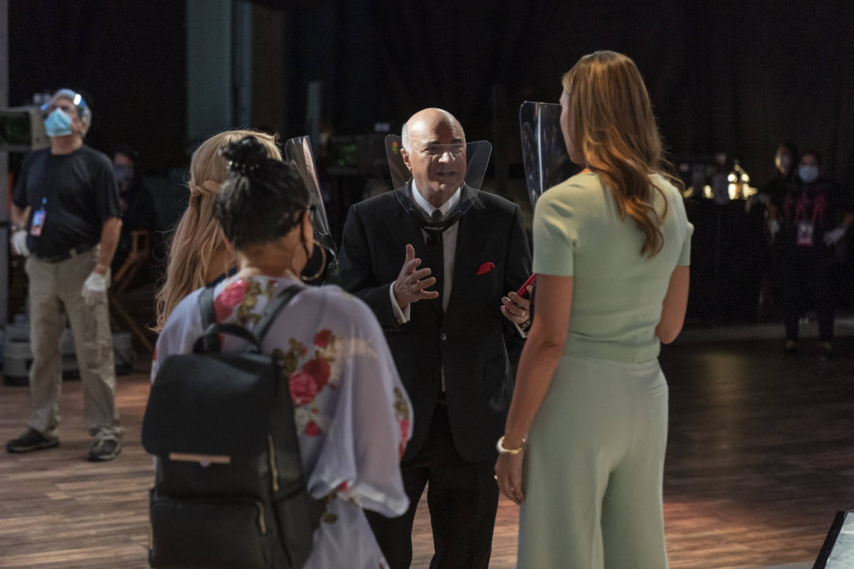 """Shark Kevin O'Leary talks with members of the """"Shark Tank"""" production, all of whom are wearing ..."""