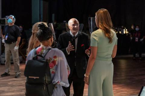 "Shark Kevin O'Leary talks with members of the ""Shark Tank"" production, all of whom are wearing ..."