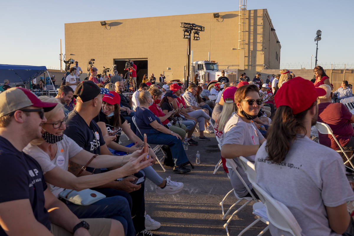 Attendees wait for Donald Trump Jr. to speak at a campaign event for President Trump on Wednesd ...