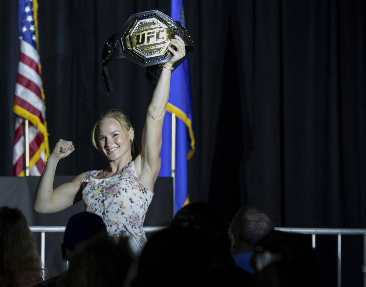Current UFC Women's Flyweight champion Valentina Shevchenko holds up her championship belt duri ...