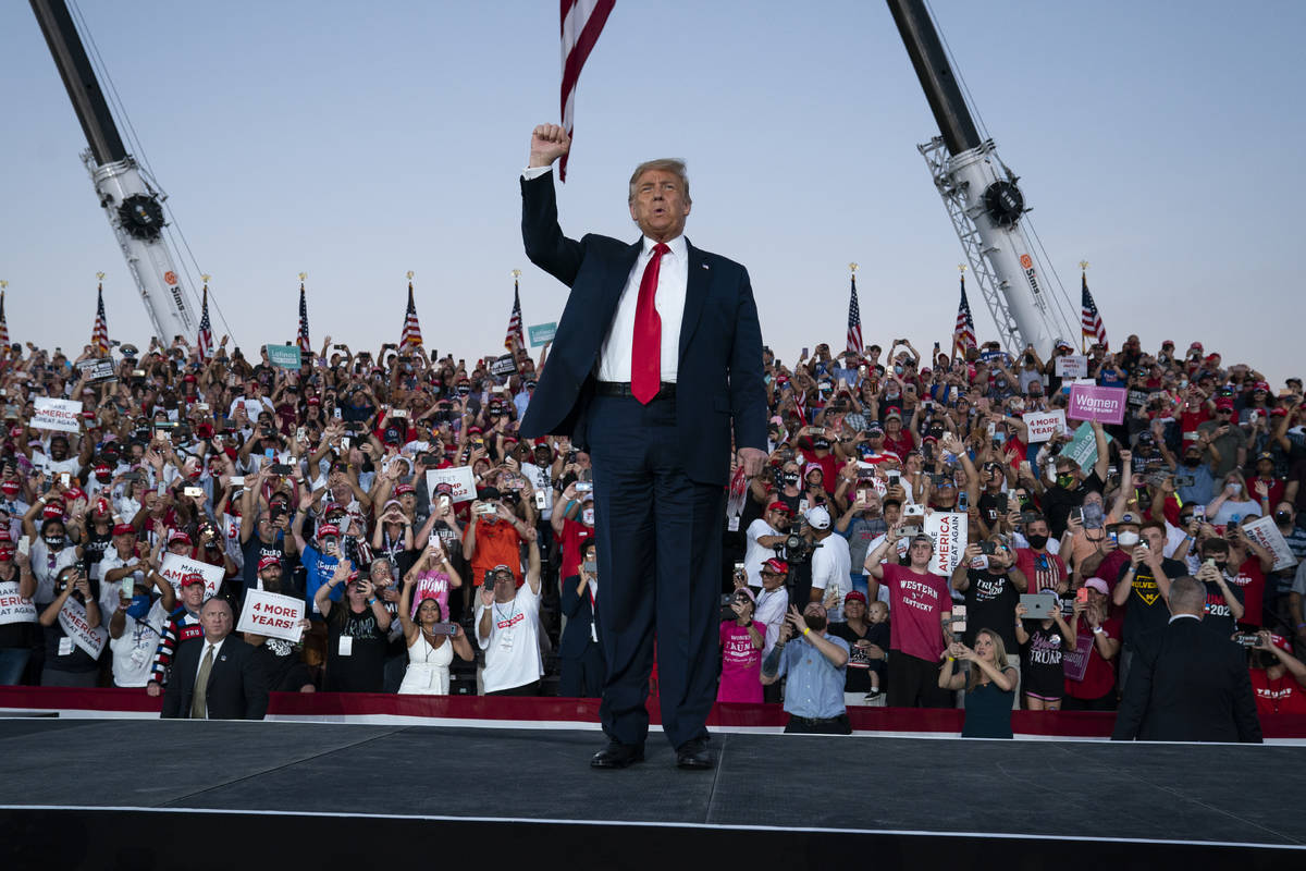President Donald Trump arrives for a campaign rally at Orlando Sanford International Airport, M ...