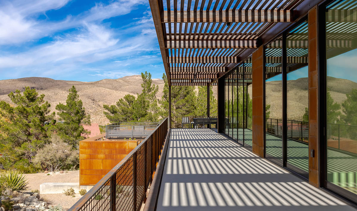 The expansive deck runs along the back of the home, offering views of the Spring Mountains. (Th ...