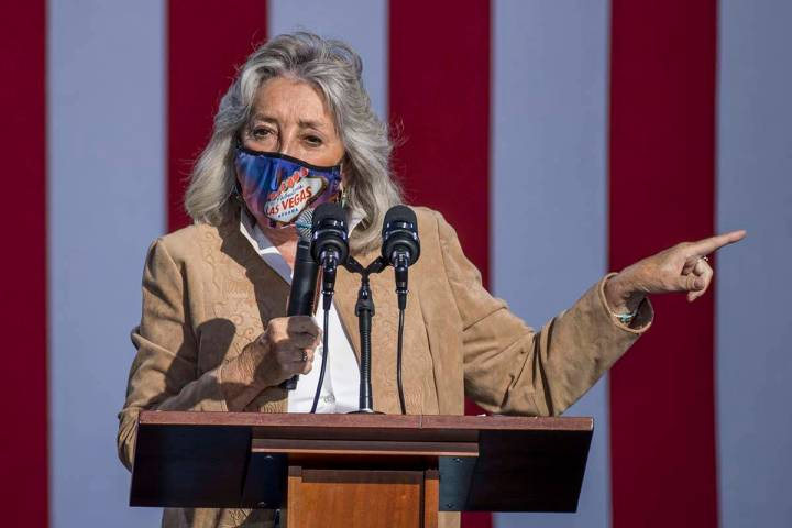 Rep. Dina Titus talks about Democratic vice presidential nominee Kamala Harris during a drive-i ...