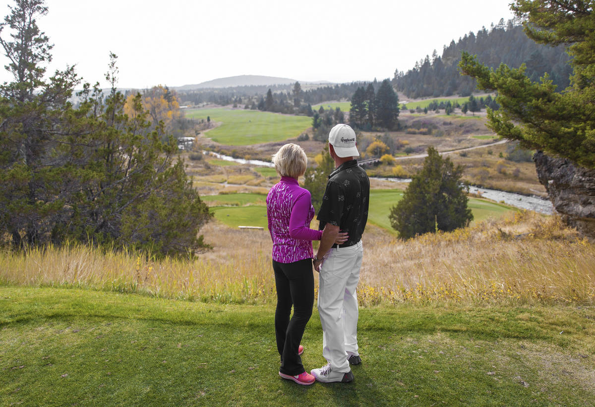 Las Vegans Gordon and Stacey Williams take in the view of the golf course at Rock Creek Cattle ...