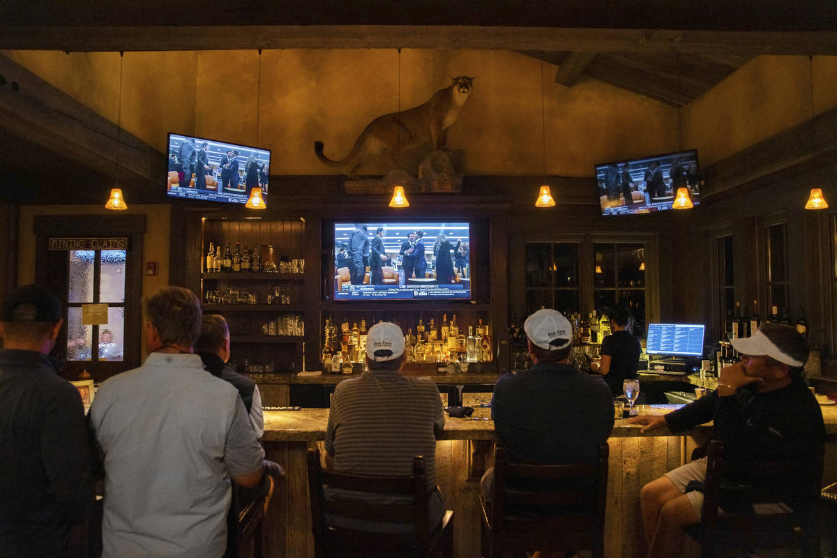 Members at Rock Creek Cattle Company watch live footage of Brendan Brisson celebrating with his ...