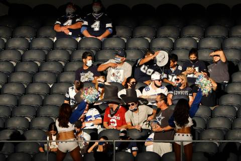 Fans watch a game between the Dallas Cowboys and the New York Giants in the second half of an N ...