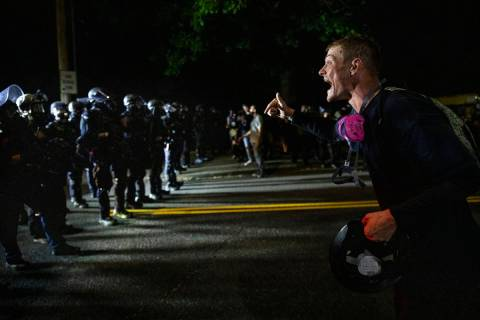 A protester screams at police as Portland protests continue. (AP Photo/Paula Bronstein)