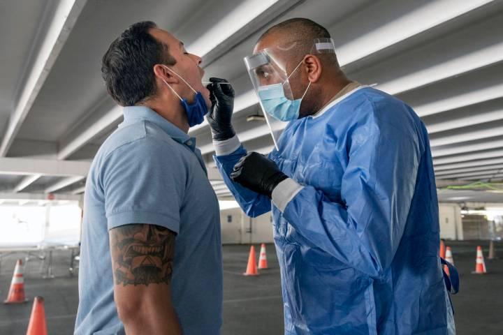 Clark County fireman Eddie Galaz, left, and Nevada National Guard Sgt. combat medic Steve Sanso ...