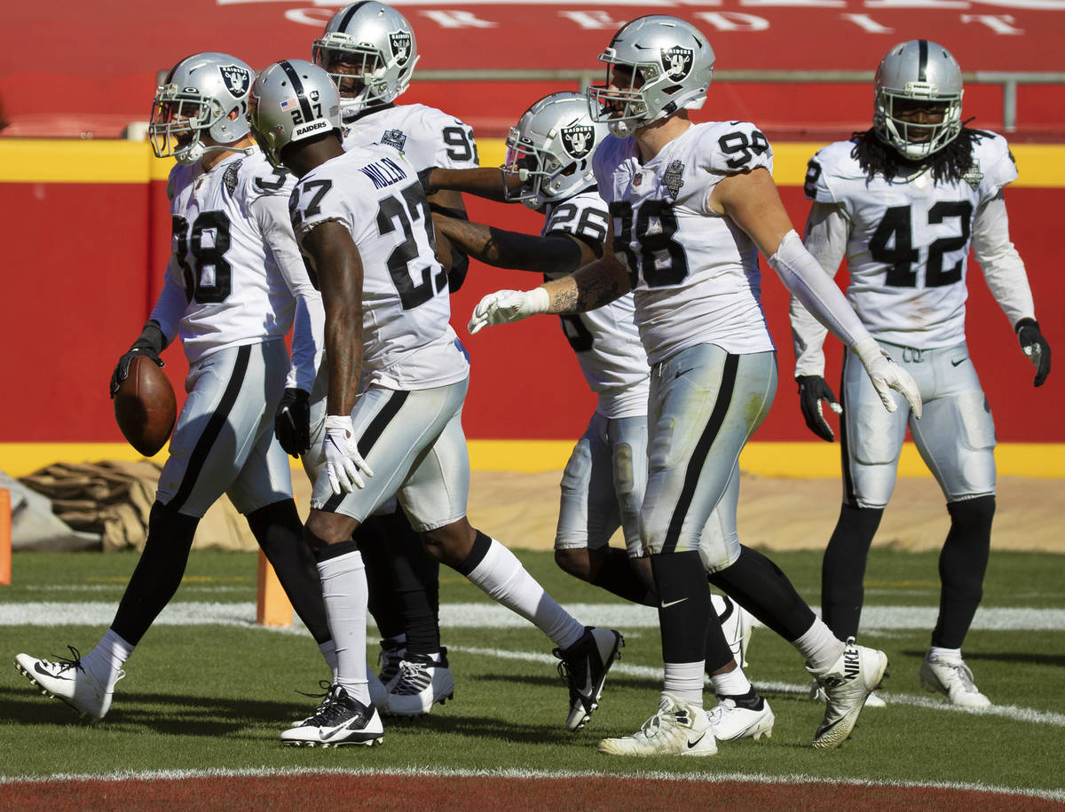 Las Vegas Raiders strong safety Jeff Heath (38) celebrates with Las Vegas Raiders cornerback Tr ...