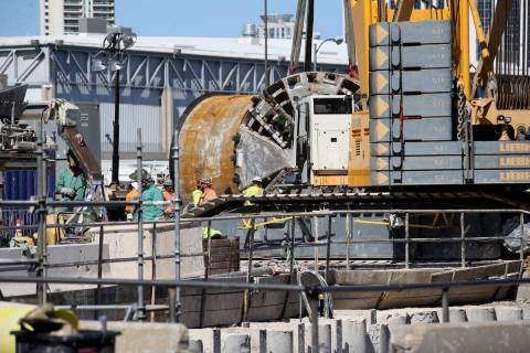The Boring Co. workers prepare to lower the drill assembly to begin work on the second tunnel i ...