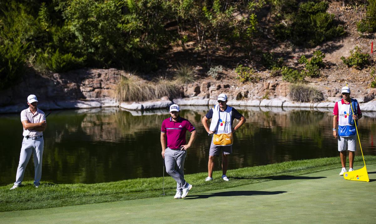 Golfers Matthew Wolff, left, and Tyrrell Hatton, second from left, watch as Jon Rahm, not pictu ...