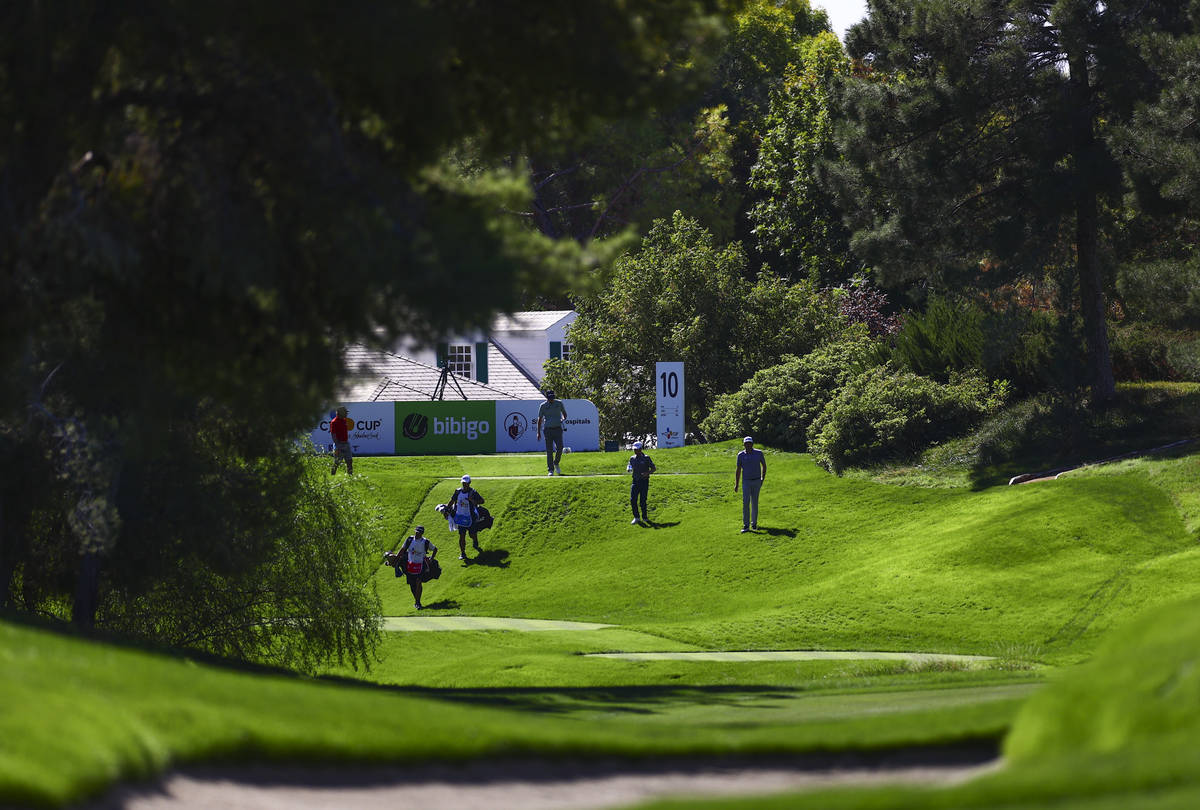 Golfers walk on the fairway of the 10th hole during the first round of the CJ Cup at the Shadow ...