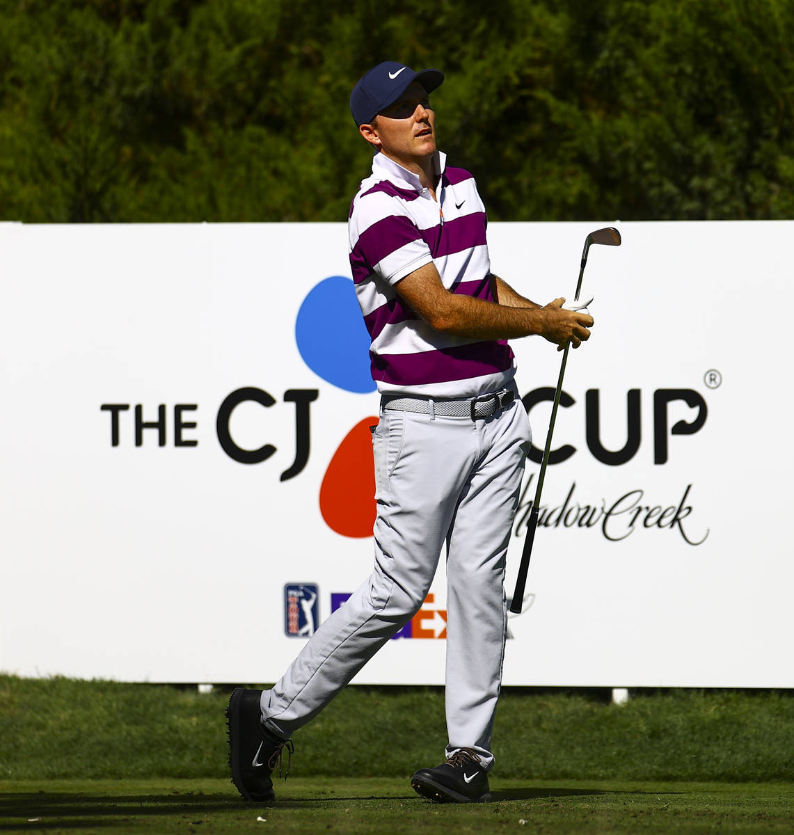 Russell Henley watches his tee shot at the fifth hole during the first round of the CJ Cup at t ...