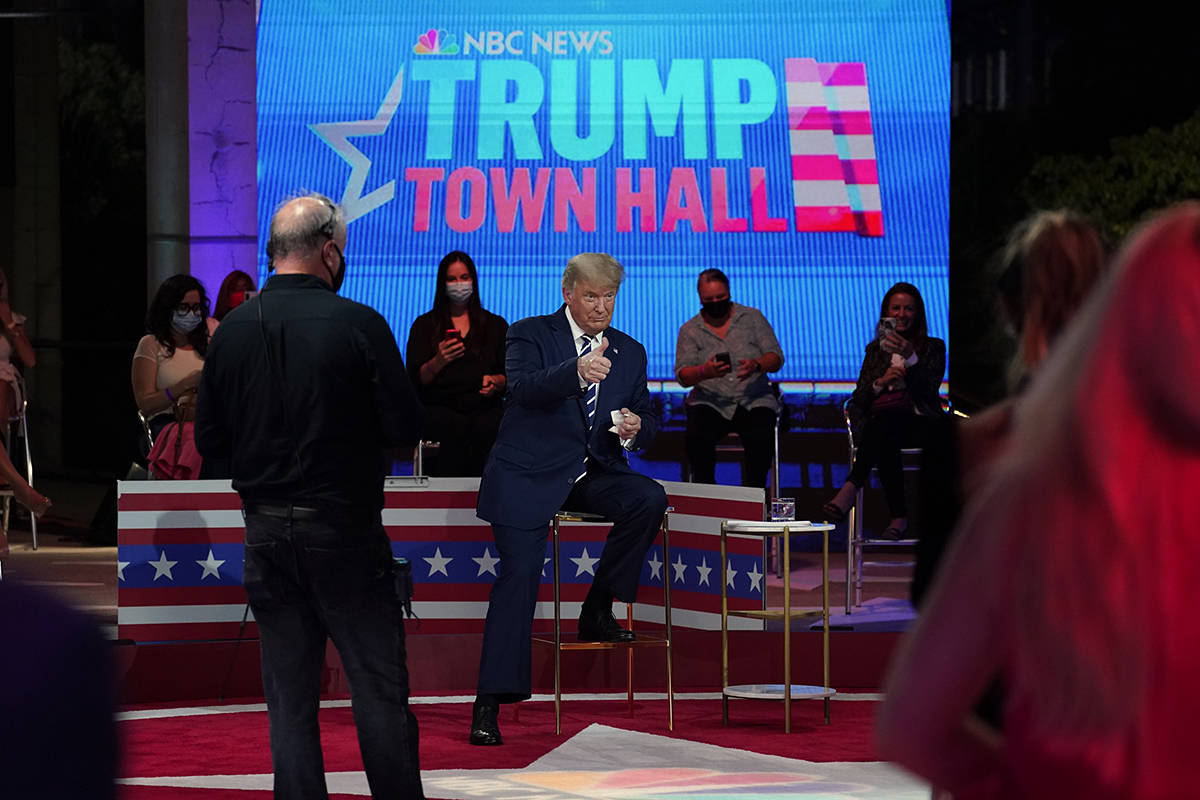 President Donald Trump gives a thumbs up during a break in an NBC News Town Hall, at Perez Art ...