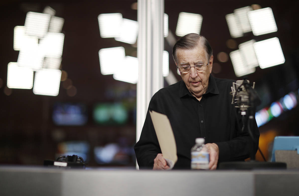 In this Nov. 16, 2017, photo, Brent Musburger looks at notes during a broadcast at the South Po ...