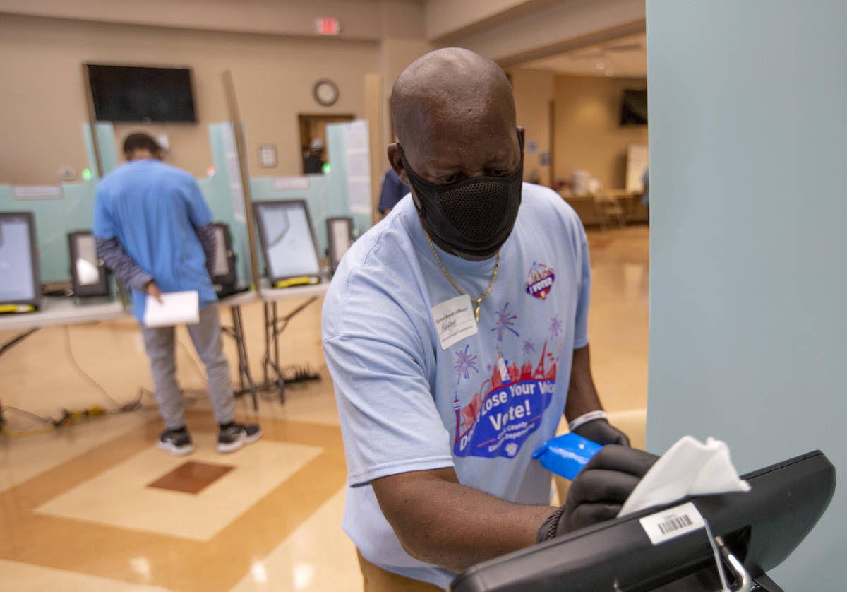 Rodney Jefferson cleans a voting machine at Doolittle Community Center during early voting on S ...