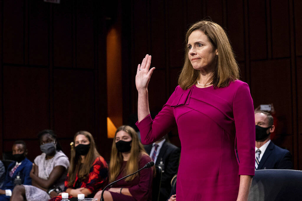 Supreme Court nominee Amy Coney Barrett is sworn in during her Senate Judiciary Committee confi ...