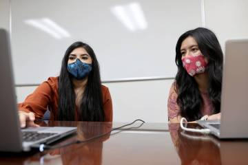 Karen Gutierrez, left, trains fellow UNLV student Leanne Villanueva on the school's COVID-19 co ...