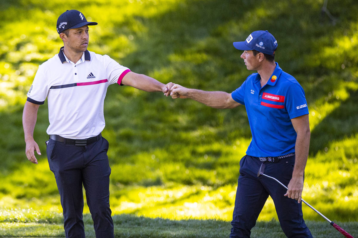Xander Schauffele, left, fist bumps Viktor Hovland after finishing the second round of the CJ C ...