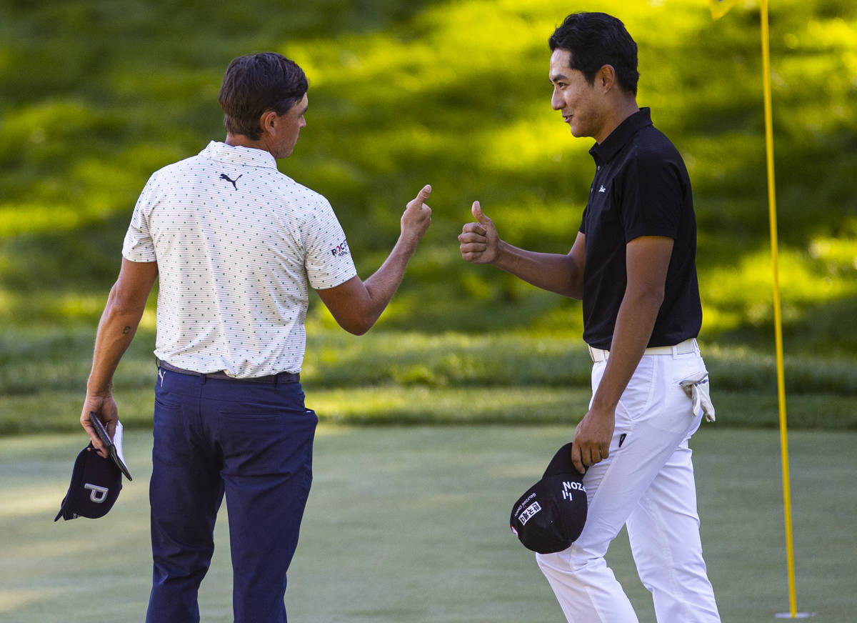 Rickie Fowler, left, and Hanbyeol Kim give each other thumbs up after finishing the second roun ...