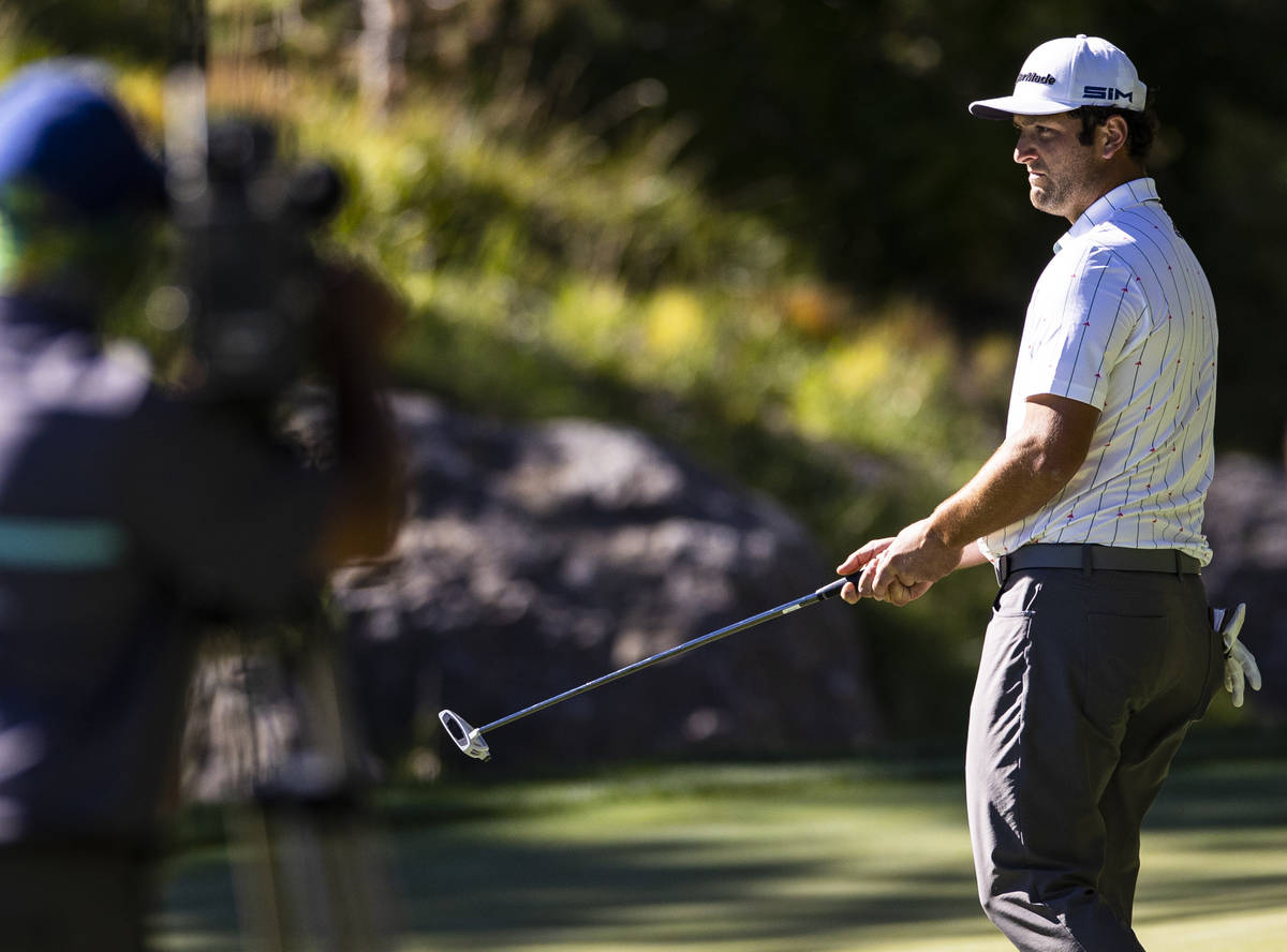 Jon Rahm reacts after missing a putt on the ninth green during the second round of the CJ Cup a ...