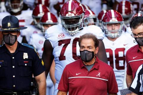 FILE - In this Sept. 26, 2020, file photo, Alabama coach Nick Saban leads his team to the field ...