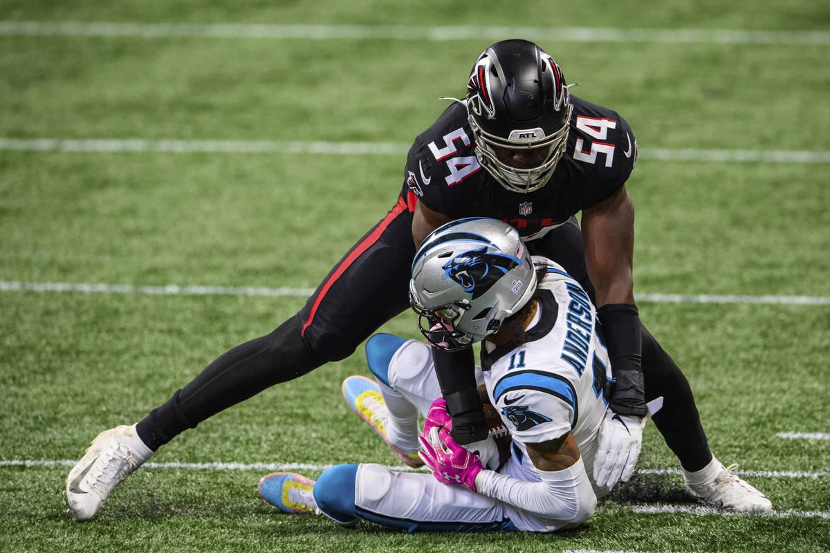 Atlanta Falcons linebacker Foye Oluokun (54) tackles Carolina Panthers wide receiver Robby Ande ...