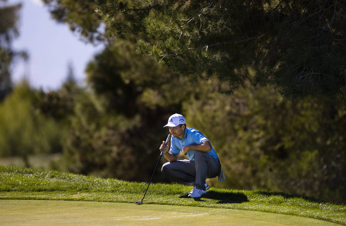 Xander Schauffele lines up a putt on the fifth green during the third round of the CJ Cup at th ...