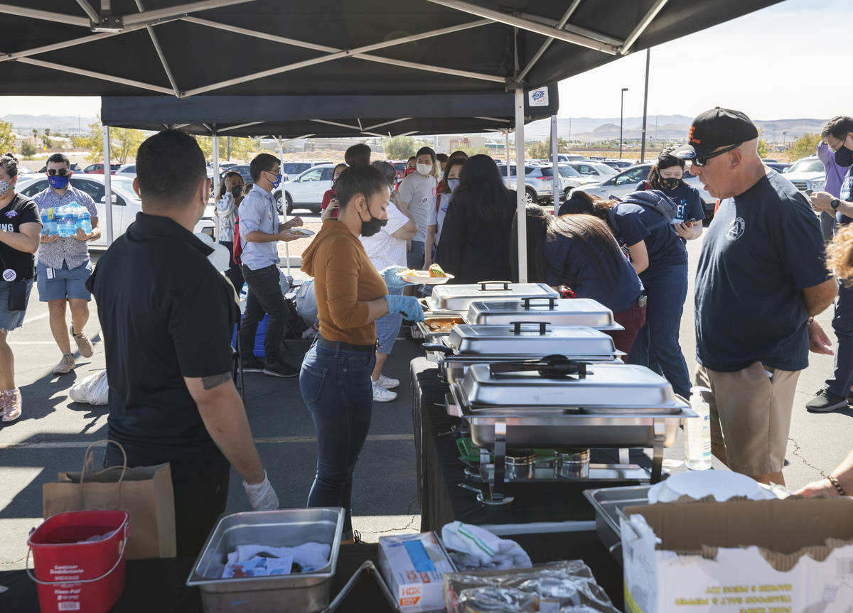 Individuals are served free food at the Desert Breeze Community Center polling site, on Saturda ...